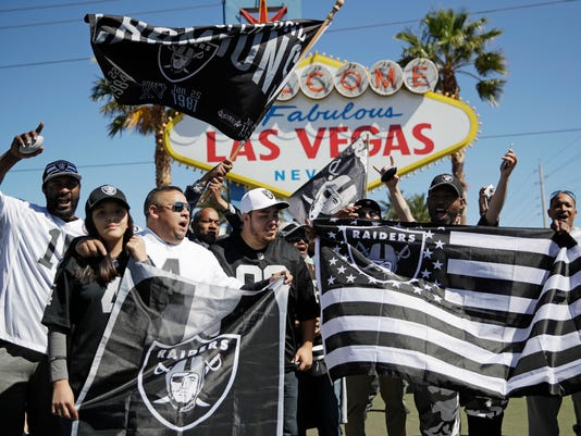 Fans cheer before the Oakland Raiders fourth round draft pick during an NFL football draft event Saturday, April 29, 2017, in Las Vegas. (AP Photo/John Locher)