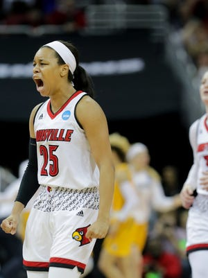 Louisville Asia Durr celebrates after Marquette calls a timeout.