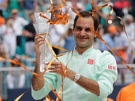 Roger Federer, of Switzerland, kisses the trophy after defeating John Isner during the singles final of the Miami Open tennis tournament, Sunday, March 31, 2019, in Miami Gardens, Fla. (AP Photo/Lynne Sladky)