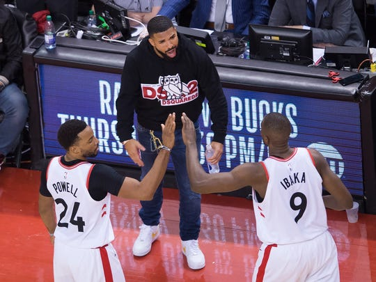 The Raptors' Norman Powell and center Serge Ibaka celebrate with Drake during Game 4. (Nathan Denette, AP)