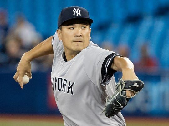 New York Yankees starting pitcher Masahiro Tanaka throws to a Toronto Blue Jays batter during the first inning of a baseball game in Toronto on Tuesday, June 4, 2019. (Fred Thornhill/The Canadian Press via AP)