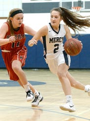 Mercy's Maggie McDonough, right, is defended by Penfield's