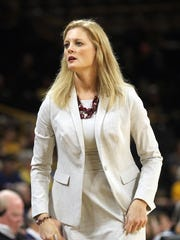 Missouri State head coach Kellie Harper brings players in to a timeout during their WNIT first round game against Iowa at Carver-Hawkeye Arena on Thursday, March 16, 2017.