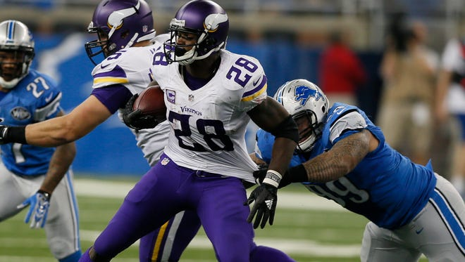 Vikings RB Adrian Peterson spins away from the tackle of Lions DLJermelle Cudjo in the third quarter of the Vikings 28-19 win on Sunday.