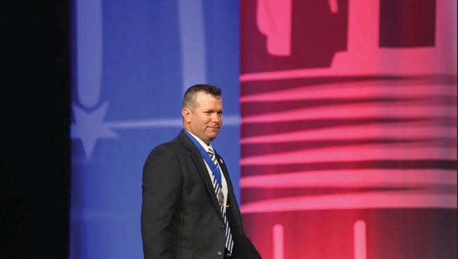 Adam Breerwood, Pearl River Community College vice president, receives the Distinguished College Administrator Award at the NerdNation, the international convention of Phi Theta Kappa honor society.