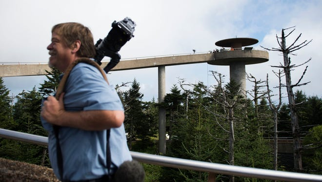 A member of the media walks up to Clingman's Dome tower while waiting for a total solar eclipse to begin in Great Smoky Mountains National Park at Clingman's Dome Tuesday, Aug. 21, 2017.