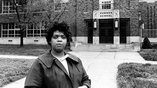 "Linda Smith, the former Linda Brown, stands in front of the Sumner School in Topeka, Kan., on May 8, 1964. The refusal of the public school to admit Brown in 1951, then age 9, because she is black led to the Brown v. Board of Education court case. In 1954, the U.S. Supreme Court overruled the ""separate but equal"" clause and mandated. She died in March at age 76."
