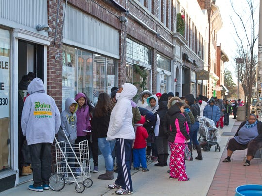 The Asbury Park Toy Drive takes over a vacant storefront in downtown Asbury Park as hundreds of people line up for gifts, clothing, and food.
