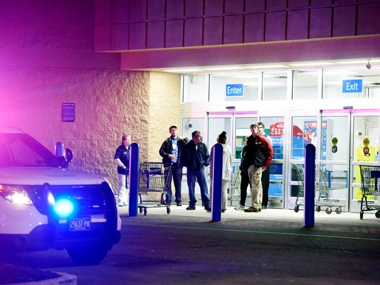 Store customers and employees wait outside after a shooting at Wal-Mart in Shrewsbury Township on April 7.