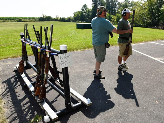 Shooters take their guns to the shooting area for the next event during the Hasty-Silver Creek Sportsmen's trap shoot Monday, Sept. 4, in Silver Creek.