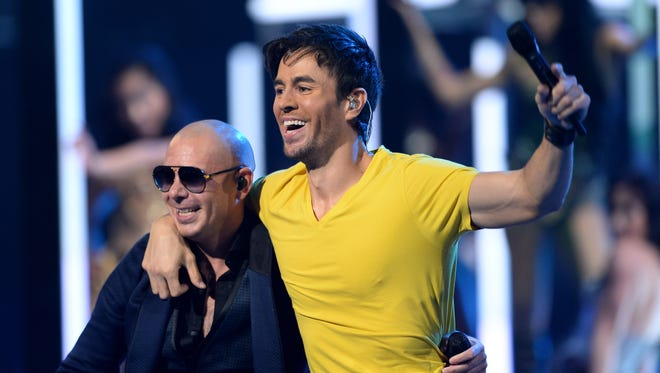 Recording artists Pitbull and Enrique Iglesias perform onstage during the 14th Annual Latin GRAMMY Awards held at the Mandalay Bay Events Center on Nov. 21, 2013, in Las Vegas. The awards show will return to Las Vegas in 2014.