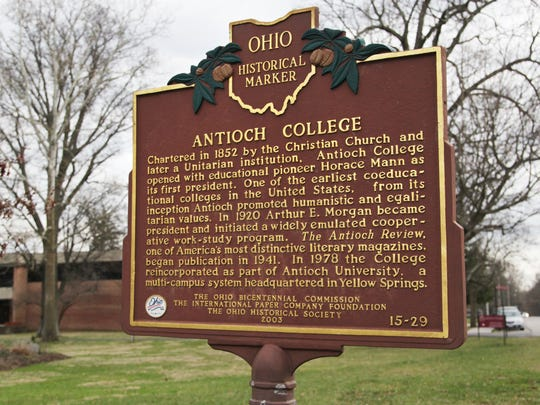 A historical marker greets visitors to Antioch College in Yellow Springs, Ohio on March 2, 2017. The marker describes how the college began and some of its attributes. It also includes information about Antioch University, from which the college separated in 2009 when alumni purchased the campus from the university. The group reopened Antioch College in fall 2011.