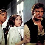 "Mark Hamill, left, as Luke Skywalker, Carrie Fisher as Princess Leia Organa, and Harrison Ford as Hans Solo in the original 1977 ""Star Wars."""