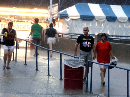Rain falls during the Def Leppard performance at the