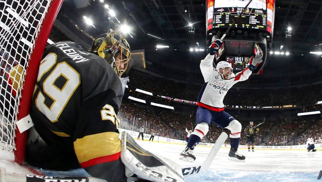 In this May 28, 2018, file photo, Washington Capitals center Evgeny Kuznetsov, right, of Russia, celebrates a goal by right wing Tom Wilson as Vegas Golden Knights goaltender Marc-Andre Fleury sits on the ice during the third period in Game 1 of the NHL hockey Stanley Cup Finals, in Las Vegas.