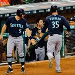 Seattle Mariners Mark Trumbo is greeted after hitting a home run against the Houston Astros  in the second inning of a baseball game Monday, Aug. 31, 2015, in Houston.