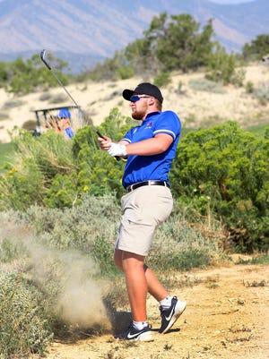 Swallows Charter Academy golfer Ben Compton shoots from the rough onto the green at the par 4 hole No. 1 at Four Mile Ranch Golf Club in Canon City.