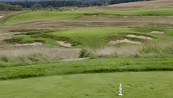 The short par-3 ninth hole is surrounded by bunkers.