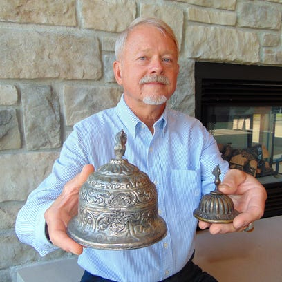 Edgar Hansen, of Manitowoc, holds an ornate metal jewelry box and matching ink well that he acquired when he was stationed with the Wisconsin National Guard in Afghanistan and Iraq between 2003 and 2010.