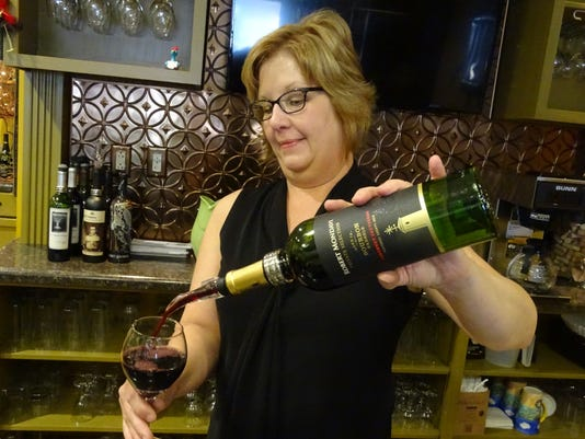 1 - Natalie Norman pouring wine
