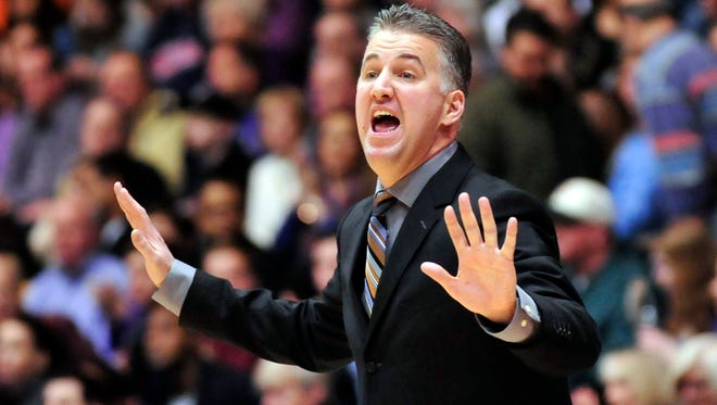 Purdue coach Matt Painter yells instructions during the first half of Saturday's 68-60 victory at Northwestern.