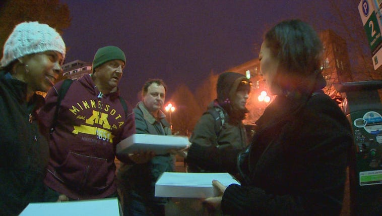 A Burien business owner delivers free pizzas to homeless