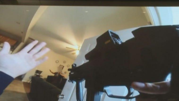 A body camera shows the inside of a Nelms Dr. home