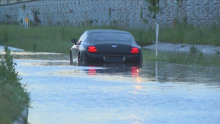 Greg Hardy's Bentley stuck in high water Friday.