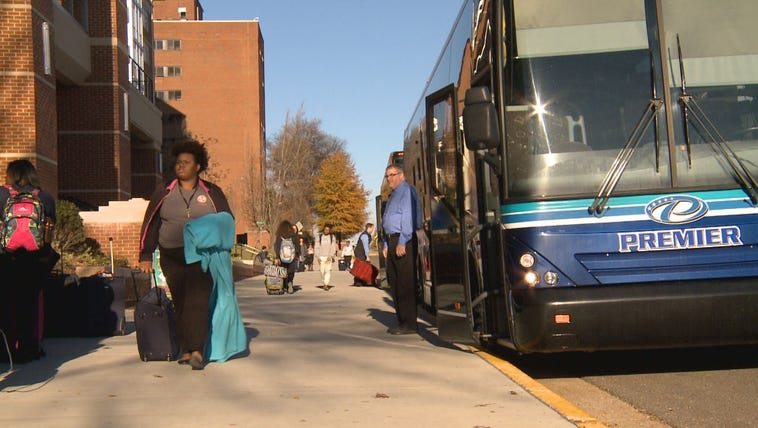 More than 100 UT students boarded two charter buses