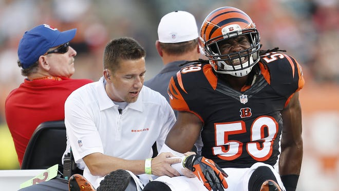 Cincinnati Bengals linebacker Emmanuel Lamur (59) is carted off the field after an injury against the Indianapolis Colts at Paul Brown Stadium. on Aug. 29.