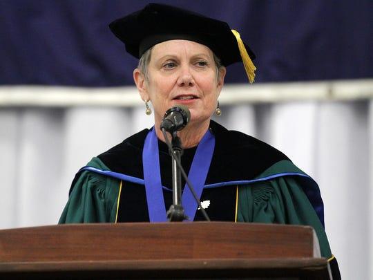 MaryAnn Baenninger, installed as the 13th President of Drew Univeristy, at the podium, Friday, October 2, 2015. Madison, NJ. For the Daily Record/Karen Fucito MOR 1002 drew president inaguration