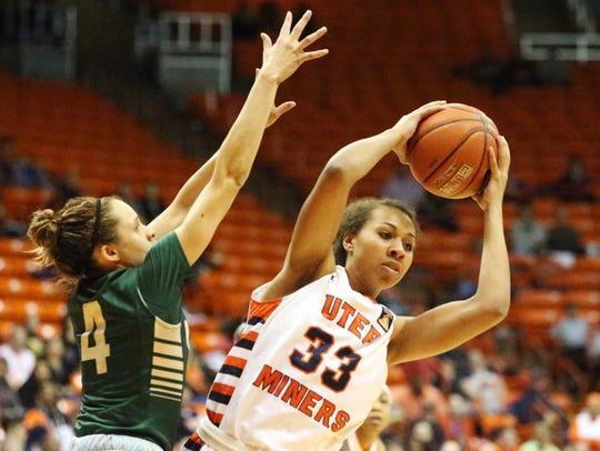 UTEP's Daeshianna McCants, 33, grabs a rebound over