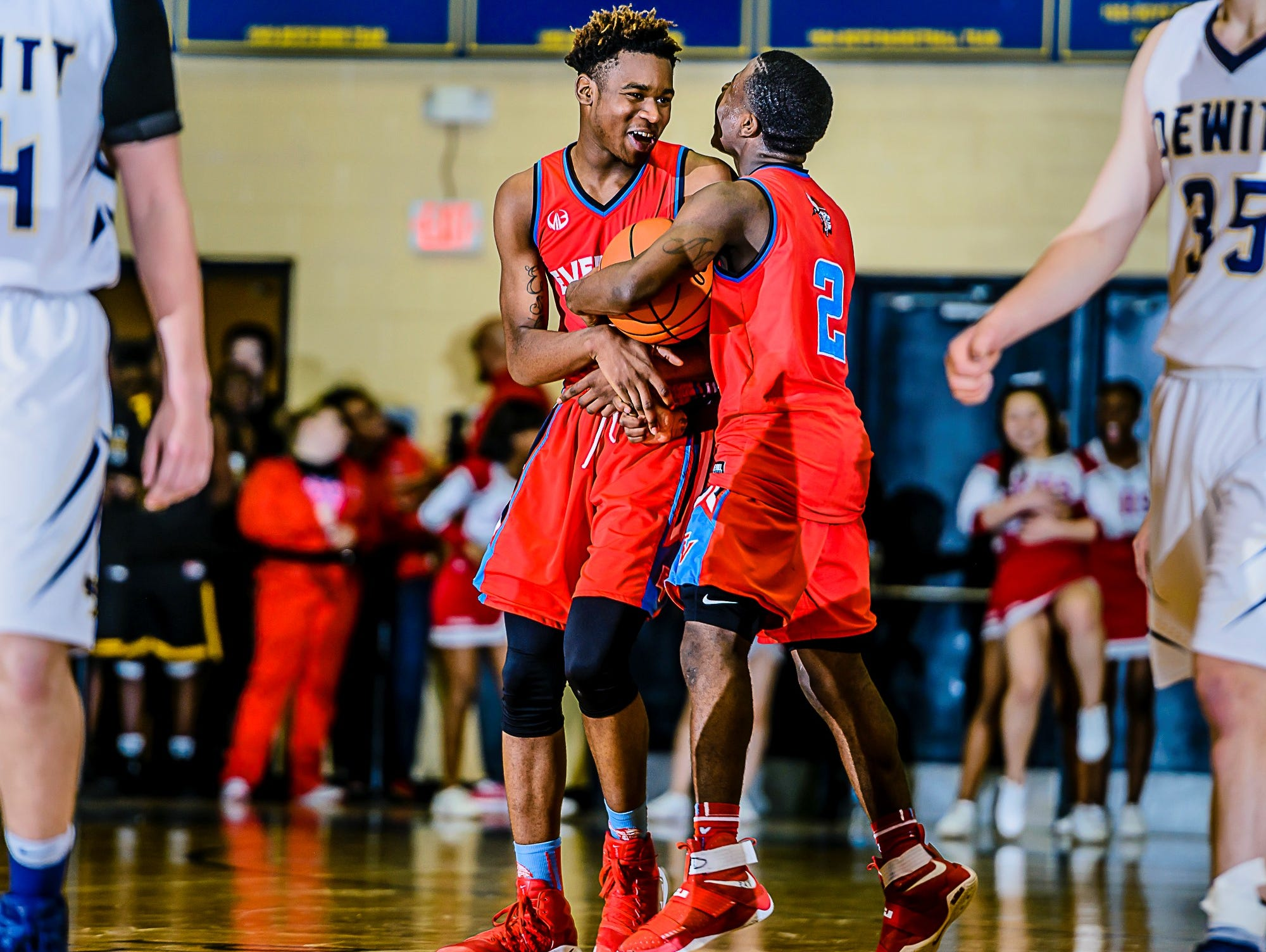 Marquez Gordon ,left, of Everett celebrates with teammate Nyreel Powell ,2, after Powell grabbed a rebound and was fouled with 9.6 seconds remaining in their Class A district semifinal game with DeWitt and Everett leading 49-47 Wednesday March 8, 2017 at Don Johnson Fieldhouse in Lansing.