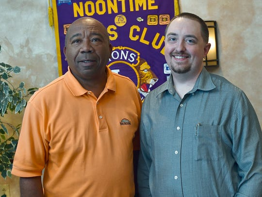 Noontime Lions Club member Barry Purvis, left,  presented