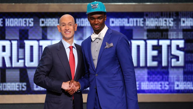 Jun 26, 2014; Brooklyn, NY, USA; Noah Vonleh (Indiana) shakes hands with NBA commissioner Adam Silver after being selected as the number nine overall pick to the Charlotte Hornets in the 2014 NBA Draft at the Barclays Center. Mandatory Credit: Brad Penner-USA TODAY Sports