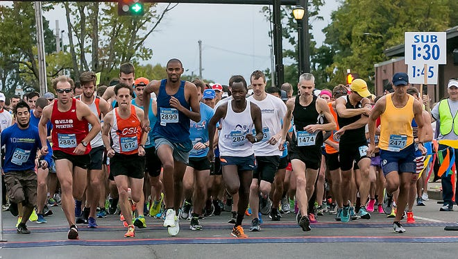 The gun goes off and the runners in the 10th annual Murfreesboro Half Marathon step off the starting line. Top finisher Micah Tirop is first to step over the starting line.