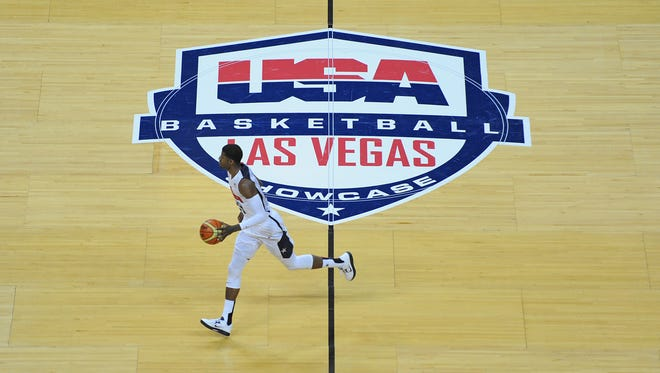 USA White Team guard Paul George dribbles the ball through mid-court during the opening minutes of the 2013 USA Basketball Showcase at the Thomas and Mack Center. Team White won the game 128-106.