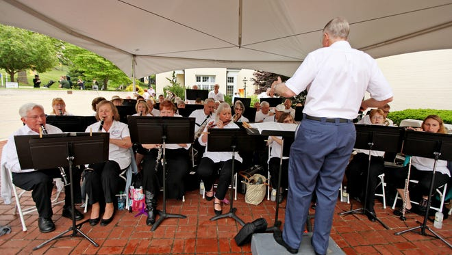 Bob Moody directs the Stonewall Brigade Band, the nation's oldest continuous community band, as they play selections during Mary Baldwin College's Commencement Ceremony on Sunday, May 17, 2015.