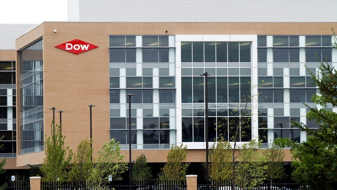 The Dow Chemical Co. headquarters stands in Midland, Michigan, U.S., on Friday, July 22, 2011. Dow, the largest U.S. chemical maker, is expected to announce quarterly earnings on July 27. Photographer:Frank Polich/Bloomberg