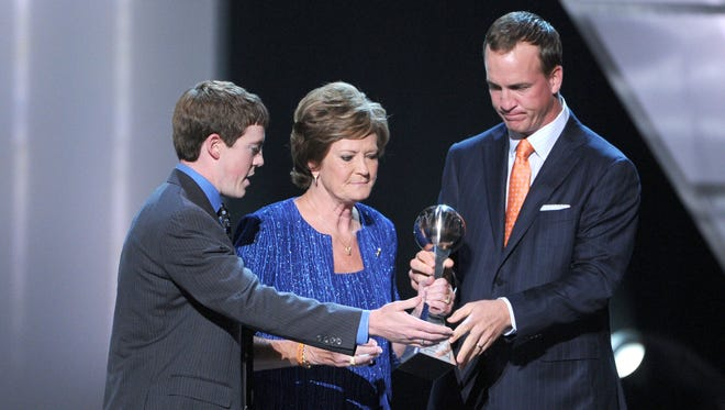 LOS ANGELES, CA - JULY 11:  Tyler Summitt (L) and Peyton Manning (R) present the Arther Ashe Courage Award to Pat Summitt onstage during the 2012 ESPY Awards at Nokia Theatre L.A. Live on July 11, 2012 in Los Angeles, California.