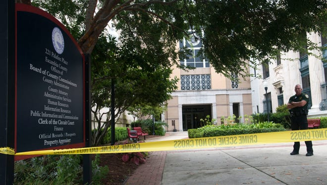 Pensacola Police investigate the scene of a fatal self-inflicted shooting at the Escambia County administration building in downtown Pensacola Friday afternoon Aug. 12, 2016.