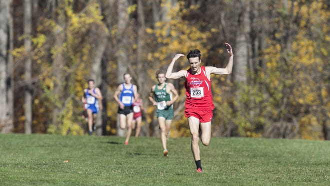 Ocean Township's Elliot Gindi wins the boys race. The cross country 2016 Meet of Champions takes place at Holmdel Park.