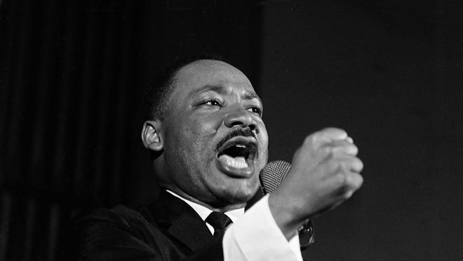 Dr. Martin Luther King Jr. shakes his fist during a speech in Selma, Ala., Feb. 12, 1965.