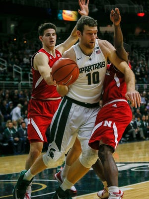 Michigan State's Matt Costello is double-teamed by Nebraska's Michael Jacobson and Glynn Watson Jr. during MSU's 72-71 loss Wednesday at the Breslin Center.