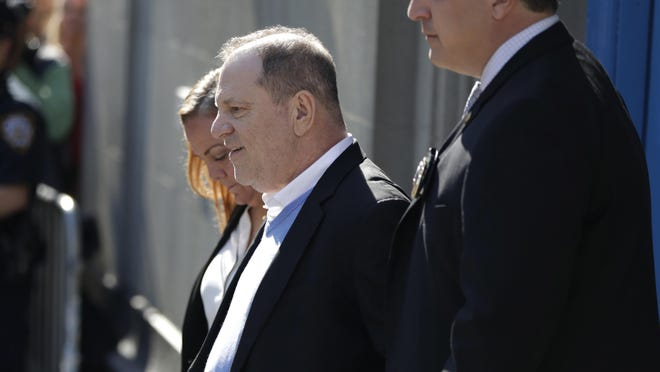 Harvey Weinstein leaves the first precinct of the New York City Police Department after turning himself to authorities following allegations of sexual misconduct, Friday, May 25, 2018, in New York. Police say Harvey Weinstein has been arrested on rape, criminal sex act, sex abuse and sexual misconduct charges for encounters with two women. (AP Photo/Julio Cortez)