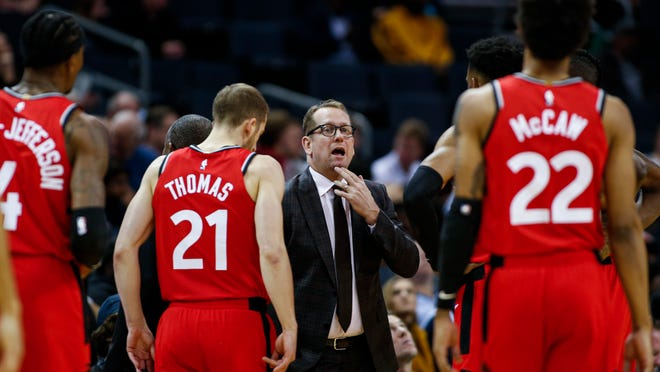 In this Jan. 8, 2020, file photo, Toronto Raptors coach Nick Nurse, center, gathers his team during a timeout in the first half of an NBA basketball game against the Charlotte Hornets in Charlotte, N.C. The Raptors have an NBA championship to defend, a very long stay at the Disney complex awaiting them and plenty of unanswered questions on how the restart of the season will work. As the NBA's lone Canadian team, there's an added complexity: The U.S. border. Nurse said Tuesday, June 9, 2020, that his team is still working through various scenarios for having workouts before heading to Disney World near Orlando, Florida along with 21 other teams next month for the restart of the season.