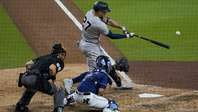 New York Yankees designated hitter Giancarlo Stanton (27) connects for a grand slam home run Monday in San Diego.