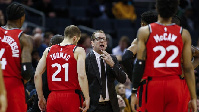 Toronto Raptors coach Nick Nurse, center, gathers his team during a timeout in the first half of a game on Jan. 8 against the Charlotte Hornets, in Charlotte, N.C.