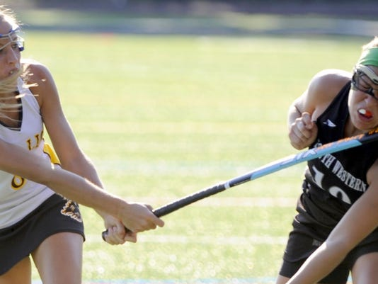 Red Lion's Ali Posey, left, hits South Western's Sydney Szparaga in the face with her stick as she follows through with her shot on goal in the second half of their field hockey game at Red Lion Thursday September 13, 2012. Red Lion won the game 5-2. DAILY RECORD/SUNDAY NEWS -- EILEEN JOYCE
