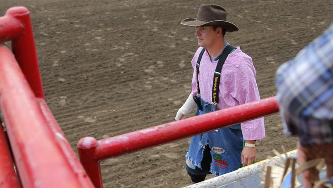 Bullfighter Eric Layton works protecting competitors during opening night of the 2015 California Rodeo Salinas on Thursday at the Salinas Sports Complex.